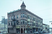 921 S 8TH ST, a Queen Anne retail building, built in Manitowoc, Wisconsin in 1899.