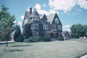 610 N 8TH ST, a Shingle Style house, built in Manitowoc, Wisconsin in 1891.