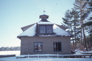 9574 COUNTRY CLUB RD, a Craftsman boat house, built in Minocqua, Wisconsin in 1930.