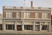 172-176 W WISCONSIN AVE, a Neoclassical retail building, built in Kaukauna, Wisconsin in 1928.