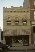 237 MAIN ST, a Romanesque Revival retail building, built in Racine, Wisconsin in 1902.