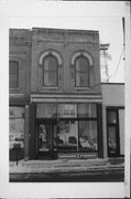 409 6TH ST, a Commercial Vernacular retail building, built in Racine, Wisconsin in 1865.