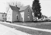 137 E 3RD ST, a Cross Gabled small office building, built in New Richmond, Wisconsin in 1883.