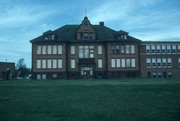 300 Cherry St., a Neoclassical elementary, middle, jr.high, or high, built in Phillips, Wisconsin in 1908.