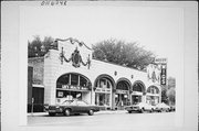 5919-27 W NORTH AVE, a Mediterranean Revival retail building, built in Milwaukee, Wisconsin in 1924.