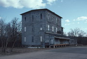 213 OBORN ST, a Astylistic Utilitarian Building mill, built in Waupaca, Wisconsin in 1884.