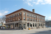 301-307 E Mill St, a Twentieth Century Commercial retail building, built in Plymouth, Wisconsin in 1906.