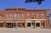 125 W MAPLE ST, a Italianate retail building, built in Lancaster, Wisconsin in 1888.
