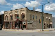148, 150, 152 E 2ND ST, a Romanesque Revival blacksmith shop, built in Kaukauna, Wisconsin in 1889.