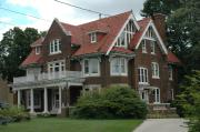 705 W WISCONSIN AVE, a Tudor Revival house, built in Kaukauna, Wisconsin in 1910.