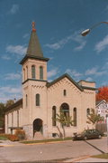 233 W HOWARD ST, a Romanesque Revival church, built in Portage, Wisconsin in 1871.
