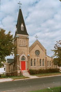 211 W PLEASANT ST, a Gothic Revival church, built in Portage, Wisconsin in 1898.