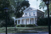 532 W WISCONSIN ST, a Greek Revival house, built in Portage, Wisconsin in 1855.