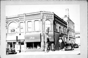 147-149-151 W HURON ST, a Queen Anne retail building, built in Berlin, Wisconsin in 1895.