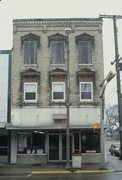 131 N MAIN ST, a Italianate retail building, built in Fort Atkinson, Wisconsin in 1857.