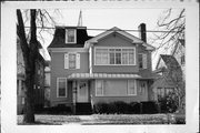 6114-6116 7TH AVE, a Second Empire house, built in Kenosha, Wisconsin in 1880.