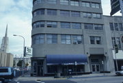 201-205 S 5TH AVE, a Art Moderne retail building, built in La Crosse, Wisconsin in 1940.