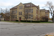 1130 Carlisle Ave., a Romanesque Revival elementary, middle, jr.high, or high, built in Racine, Wisconsin in 1890.