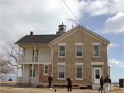 5117 4TH AVE, a Gabled Ell light house, built in Kenosha, Wisconsin in 1866.