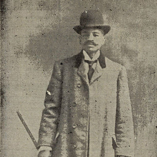 "Portrait of Professor Ephraim ""Eph"" Williams looking a bit mysterious with his bowler hat and cane."