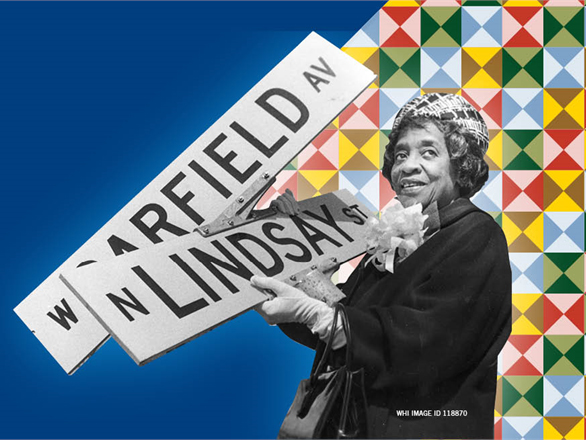 African American Woman with street signs, and a quilt in the background