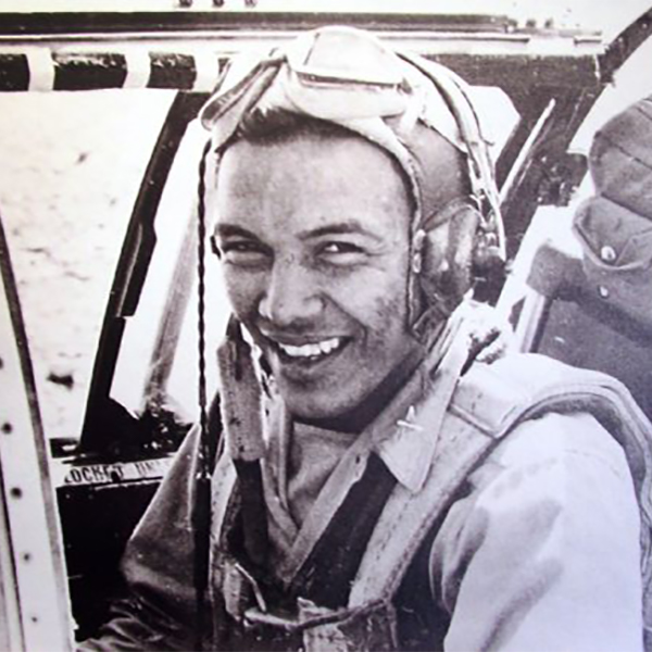Portrait of Josh Sanford sitting in an airplane during WWII. Sanford served in the Army Air Corps during WWII and is credited with being the only Native American pilot to serve in China. Sanford eventually reached the rank of Captain, won the Fly Cross Award, and took part in at least 74 combat missions..