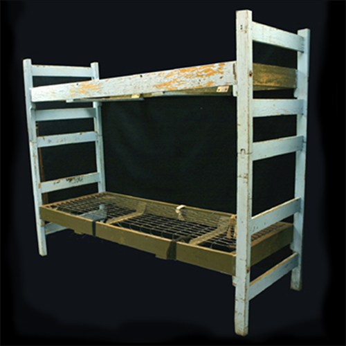 Bunk beds used by the Contreras family, Mexican-American migrant workers, in Wautoma, Wisconsin, 1970s-1980s.