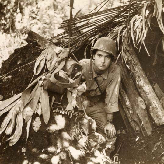 Robert Doyle emerges from a captured Japanese pillbox at Buna, Papua New Guinea.