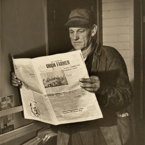 Man reading the Union Farmer, an old newspaper