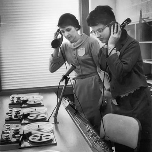 Language teachers listen to foreign languages on tape decks at an institute for public school language teachers at Mount Mary College.
