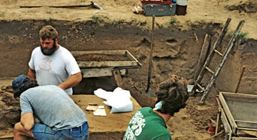 A team of archaeologists carefully searches a dig site near La Crosse, Wisconsin.