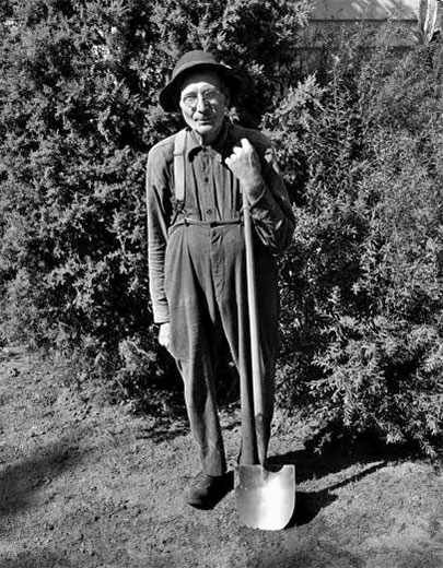 A man holding a shovel in his yard, 1947. WHI 48361.