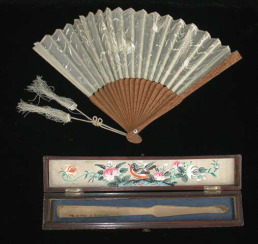 Fan and box. Off white silk embroidered fan with sandalwood sticks.