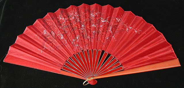 Monochromatic red silk fan with red birds and pink flowers.