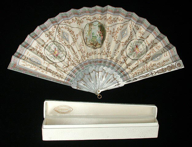 Off white fan embroidered with scrolling vines, cupid's arrows and a scene of Aphrodite.