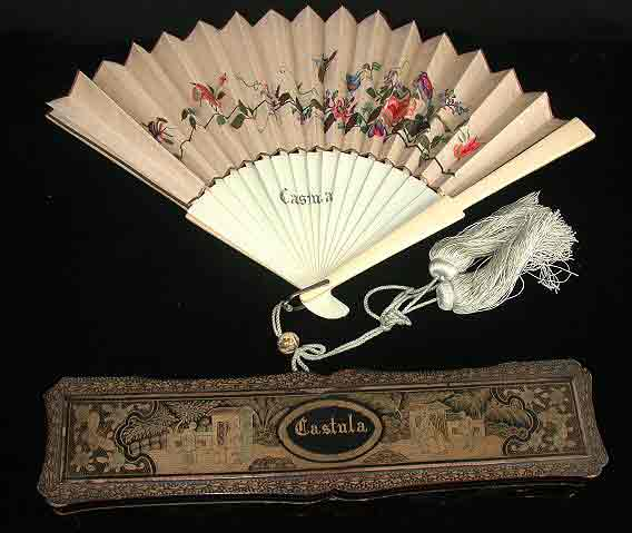 Castula fan, off white and tan background, embroidered with birds sitting on a flowering branch.