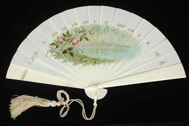 White fan decorated with central painted scene of swan lake.