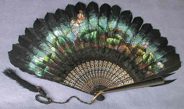 Black feather fan with green painted details.