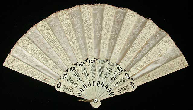 Monochromatic white satin and lace fan with carved sticks and alternating pattern.