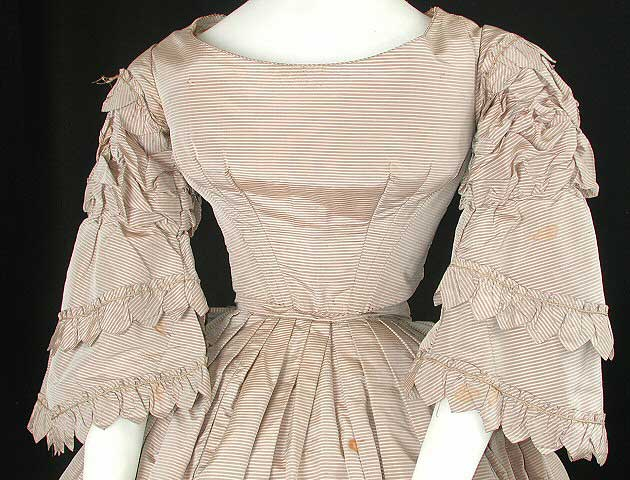 Front detail of tan and off-white striped silk wedding dress. Gift of Elizabeth Marshall. <br />Wisconsin Historical Museum object # 1945.974.