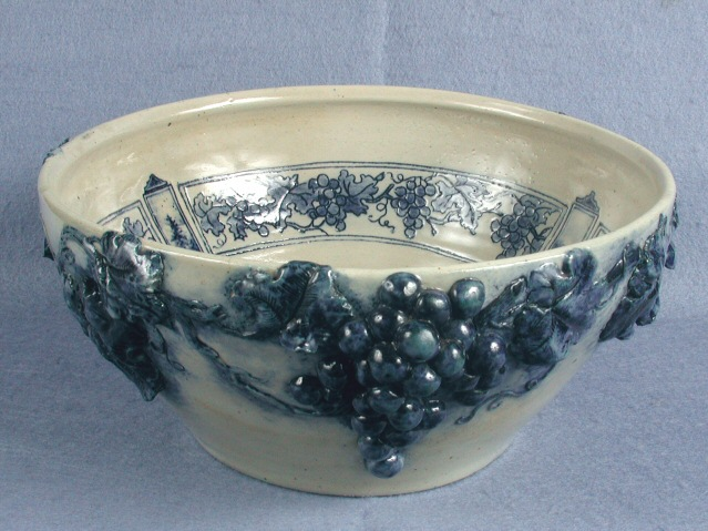 Art pottery punch bowl, punch bowl, stoneware, blue molded grape design.