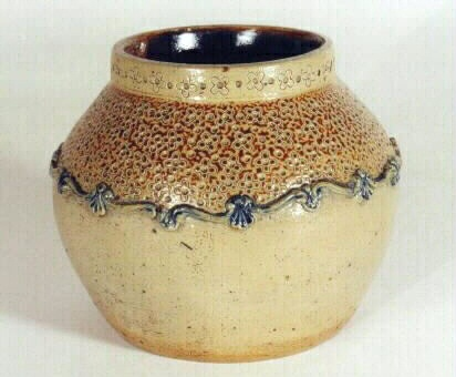 Art pottery jar, salt glaze stoneware, applied blue festoon design, brown interior.