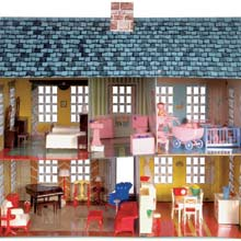 Interior of dollhouse with toy plastic furniture.