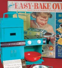 Blue easy bake oven toy with plastic red bowl.